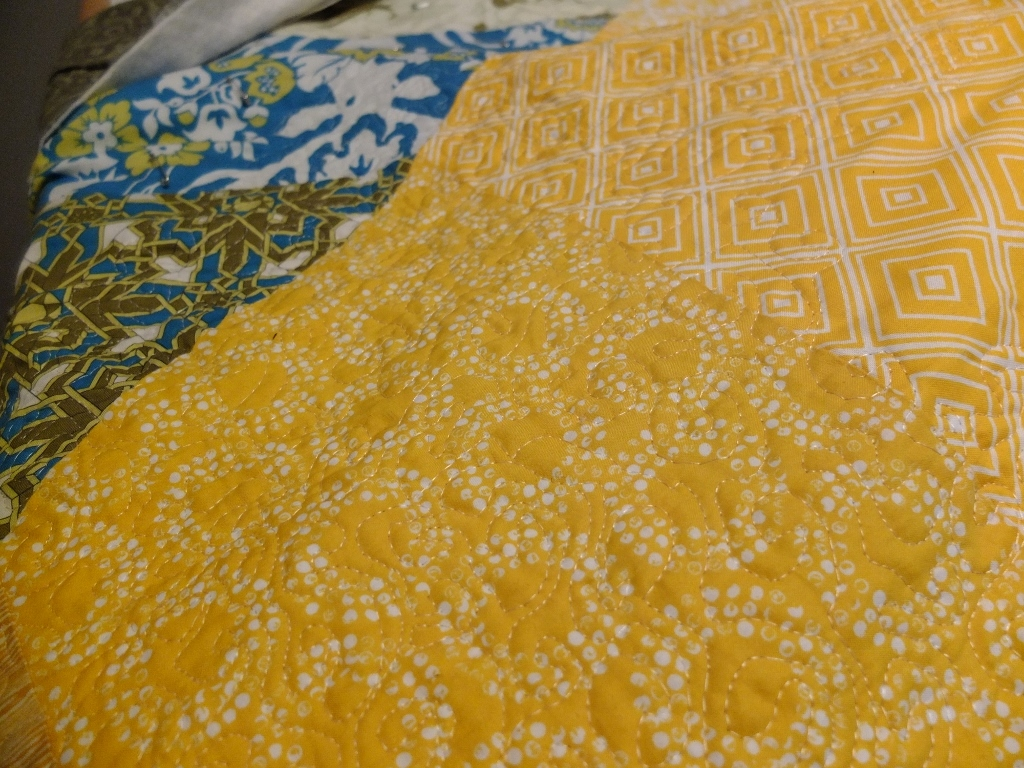 Hex yellow quilted detail